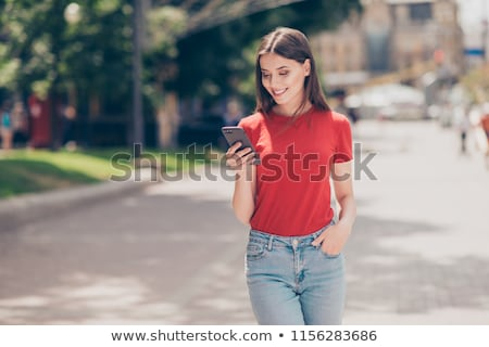 Beautiful fashion woman holding her hands in pocket. Stock photo © feedough