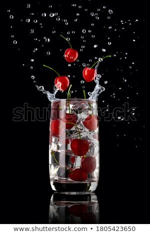 Three cherries in a glass drops splashing Stock photo © RuslanOmega