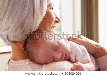 nagymama · baba · mosolyog · törődés · boldogság · bent - stock fotó © IS2