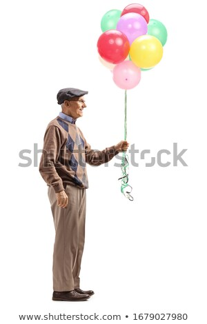 mature man holding balloons. Stock photo © IS2
