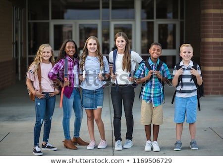 photo of cheerful african american students wearing backpacks ho stock photo © deandrobot