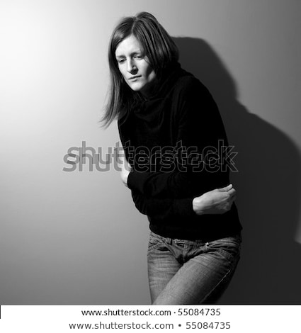 Young woman suffering from a severe stomach pain/depression Stock photo © lightpoet