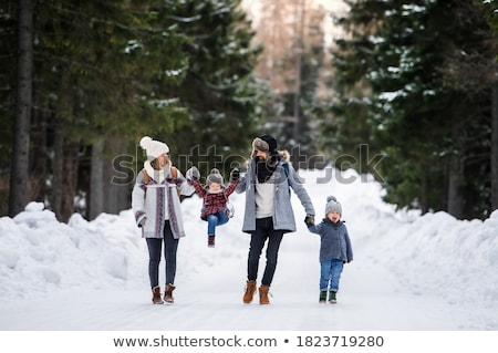 Winter Family Walks, Father Mother and Children Stock photo © robuart