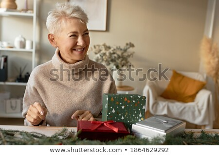 senior woman wrapping christmas presents stock photo © nyul
