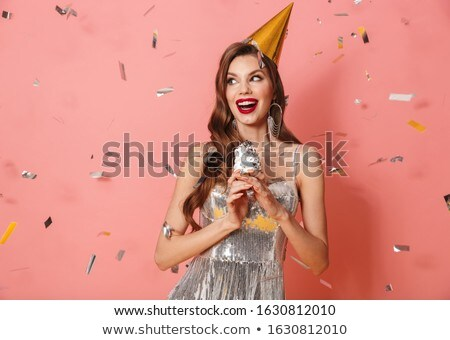 Woman in bright sequins dress holding cupcake Stock photo © deandrobot