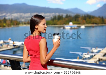 Vancouver city Asian canadian woman drinking coffee at harbor view during office break in the mornin Stock photo © Maridav