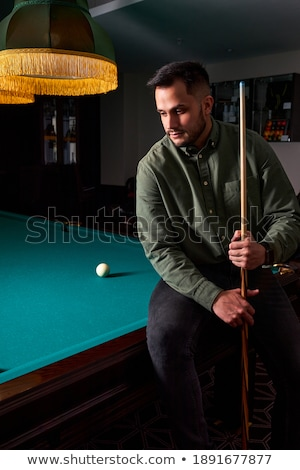 handsome man with suit sitting in billiard pool Stock photo © lunamarina