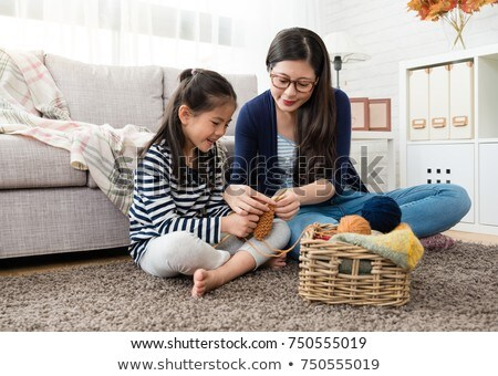 A mother teaching her daughter how to knit. Stock photo © photography33