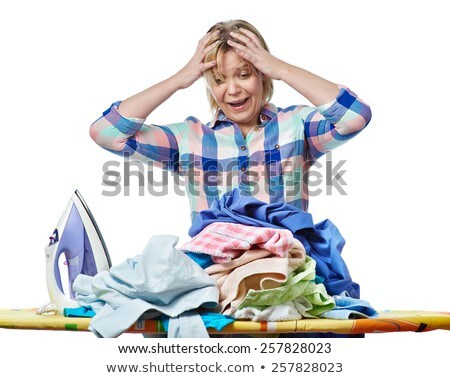 Elderly woman ironing towels at home  Stock photo © Andersonrise