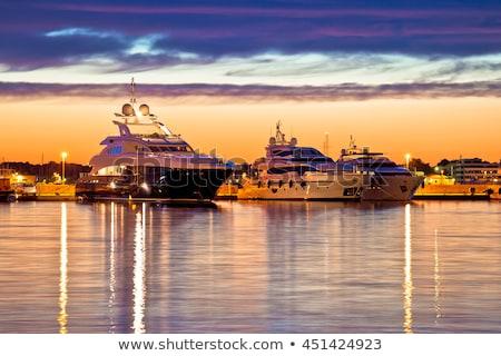 luxury yacht sailing at dusk stock photo © silkenphotography