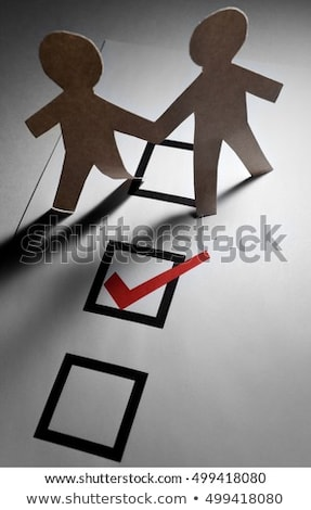 Jelölőnégyzet papír lánc férfiak közelkép Stock fotó © devon