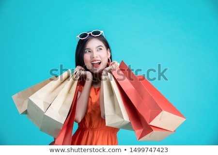 portrait of a shocked asian woman in dress standing stock photo © deandrobot