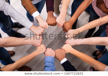 People Hands Joining Their Fist To Form Circle Stock photo © AndreyPopov