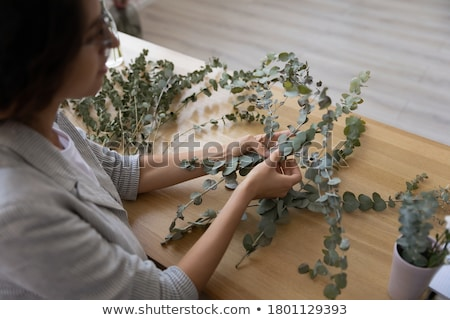Adding green branches to bouquet Stock photo © pressmaster