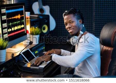 Boldog fiatal zenész fejhallgató nyak dolgozik Stock fotó © pressmaster