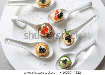 Canapes with red caviar   . Stock photo © fanfo