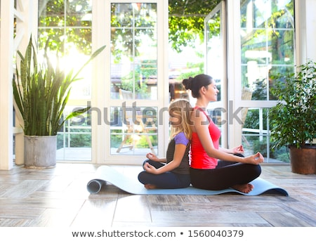 Young brunette woman with little daughter in a sporty uniform do Stock photo © dashapetrenko