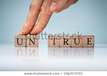 Fingers Over The Un True Blocks Against Reflective Background Stock photo © AndreyPopov