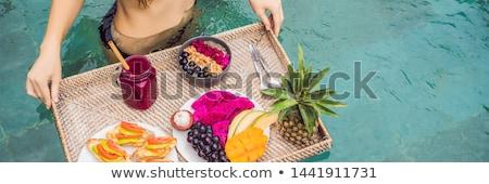 BANNER, LONG FORMAT Breakfast tray in swimming pool, floating breakfast in luxury hotel. Girl relaxi Stock photo © galitskaya