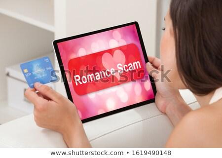 женщину используя ноутбук романтика жульничество применение экране Сток-фото © AndreyPopov