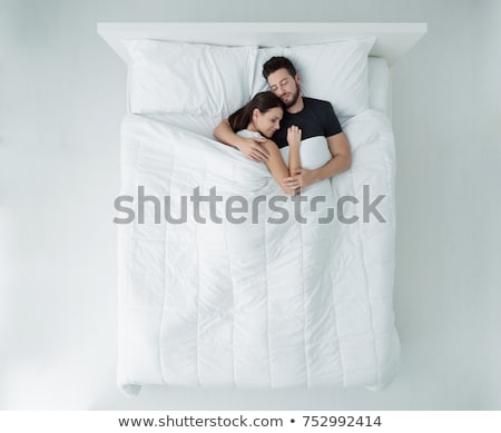 View at affectionate lovers embracing on bed at home Stock photo © boggy
