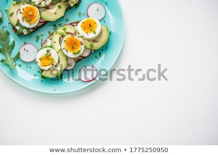 Sandwich with fresh avocado and onion on a plate Stock photo © joannawnuk