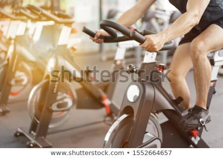 Adam bisiklete binme egzersiz bisiklet spor salonu Stok fotoğraf © Lopolo