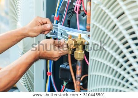 Munkás javít levegő állapot felszerlés villanyszerelő Stock fotó © simazoran