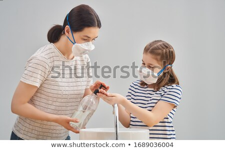 Stock photo: Family Wearing Facemasks And Washing Hands