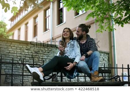 сидят скамейке осень парка Сток-фото © deandrobot