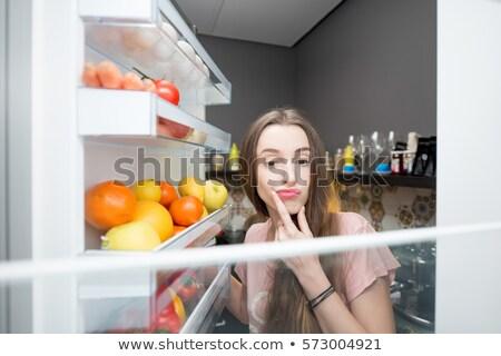 Alimentação comida geladeira noite faminto pessoa Foto stock © AndreyPopov