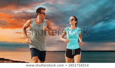 Gelukkig vrouw sport kleding zee fitness Stockfoto © dolgachov