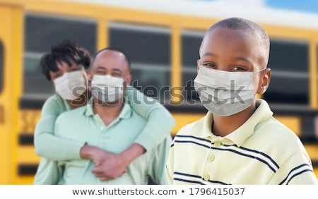 Young African American Student and Parents Near School Bus Weari Stock photo © feverpitch