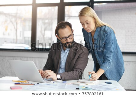 Portrait of two women working at their desks Stock photo © HASLOO