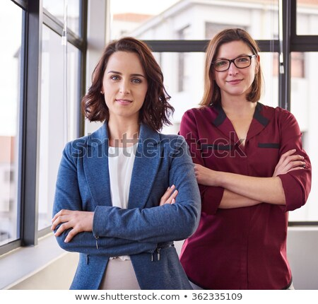 portrait of two young business women at their office stock photo © hasloo