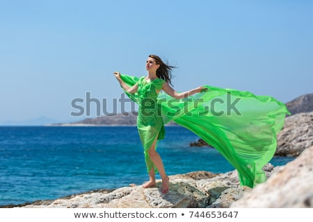 Stock photo: woman in green dress barefoot