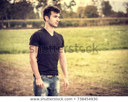 Young man relaxing on the grass with friends Stock photo © photography33
