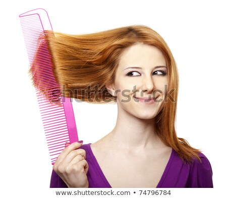 Stock photo: Funny red-haired girl with big comb.