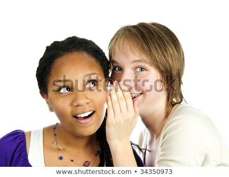 teens whispering and gossiping stock photo © godfer