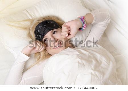 csinos · szőke · nő · ki · ágy · mosoly · fektet - stock fotó © stryjek