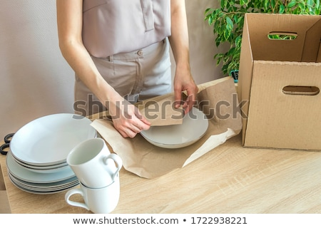 Women moving white plate Stock photo © photography33