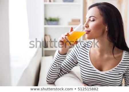 Morena vidrio jugo de naranja sonrisa feliz Foto stock © photography33