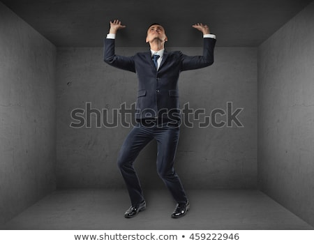 Businessman pushing ceiling Stock photo © photography33