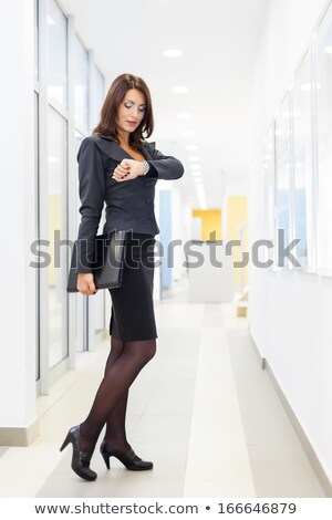 happy young business woman standing down stock photo © feedough