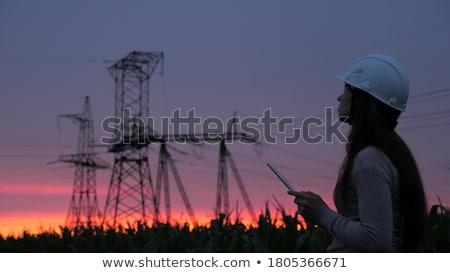 ストックフォト: 電気 · 日没 · フィールド · 電源 · 赤