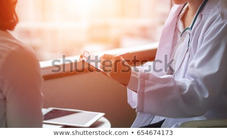 doctor consulting a chart stock photo © photography33