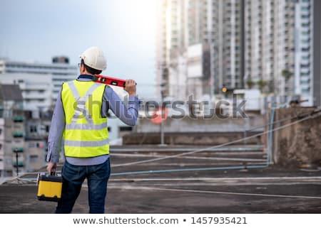 Builder holding spirit level. Stock photo © photography33