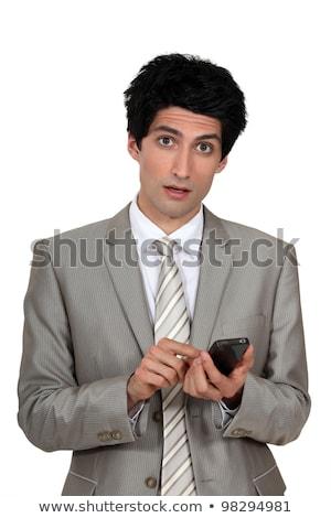 üzletember · küldés · szöveges · üzenet · telefon · szemek · mobil - stock fotó © photography33
