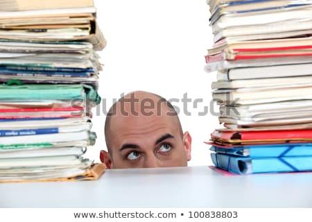 Man peering at files Stock photo © photography33