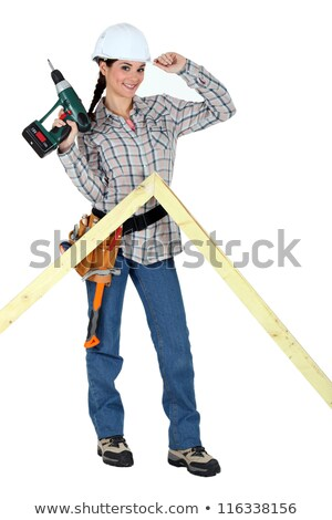 portrait of lovely female carpenter holding electric drill stock photo © photography33